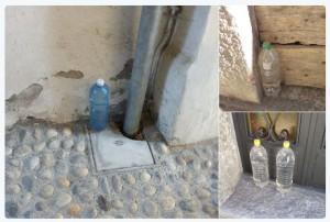wasserflaschen-vor-tuer